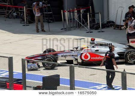 Lewis Hamilton leaves the pit for friday practice