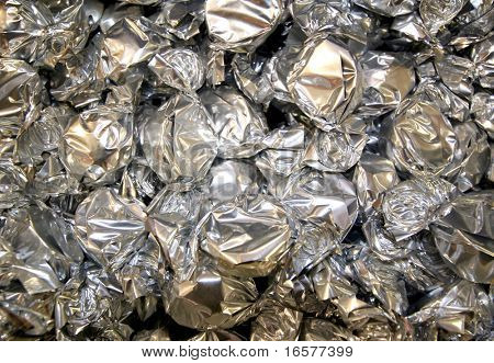 Silver wrapped candy background