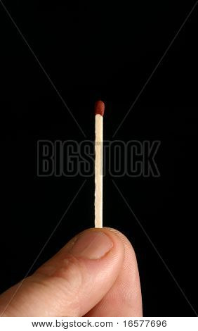 Macro of a man holding a safety match