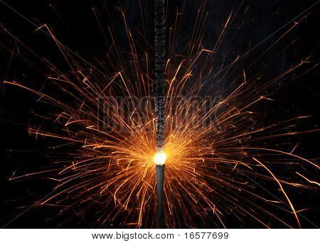 Close up of lit up sparkler