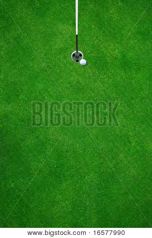 Golfball almost in the hole on a beautiful golf course - top view