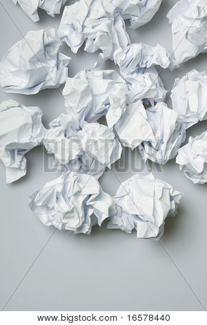 Crumpled paper wads on the floor - copy space below