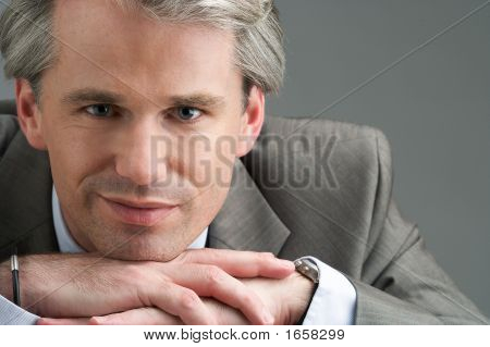 Portrait Of A Smiling Businessman With His Hands