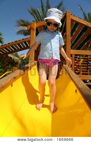 Tropical Girl On Slide