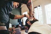 Professional Barber Shaving Customer poster