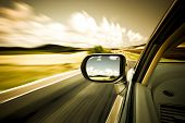 stock photo of acceleration  - car on the road wiht motion blur background - JPG