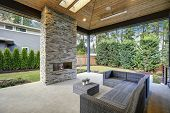Chic Patio Design With Vaulted Ceiling And Stone Fireplace poster