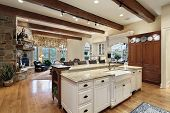 Kitchen in luxury home with stone fireplace
