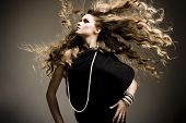 image of hair motion  - Portrait of a beautiful girl with flying blond hair - JPG