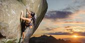 Female Climber Climbing Big Boulder In Nature With Rope poster