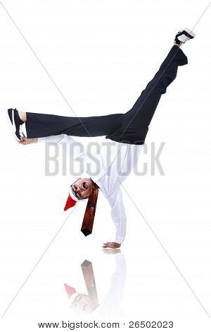 Asian Businessman With Christmas Hat Doing Handstand