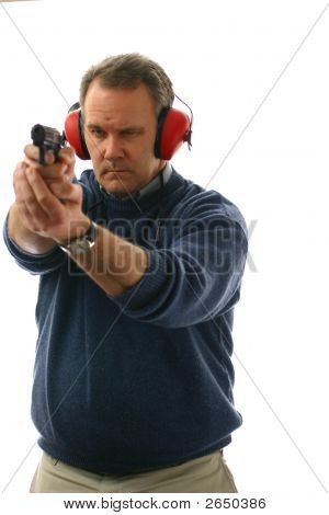 Man Firing Handgun At Range