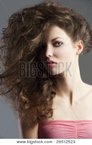 Pretty Girl With Great Hair Style, She Is Portrayed At Middle Bust