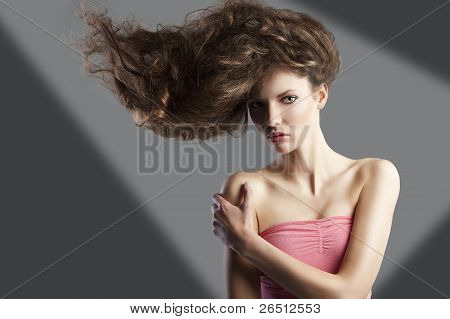Pretty Girl With Great Hair Style, She Has Left Hand On The Right Shoulder