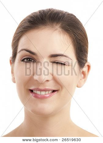 Portrait of a beautiful young woman winking, isolated on white