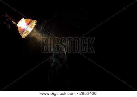 Smoke In The Light Of A Bulb