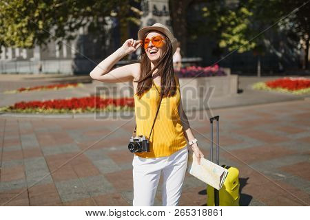 poster of Joyful Traveler Tourist Woman In Orange Heart Glasses With Suitcase City Map Retro Vintage Photo Cam