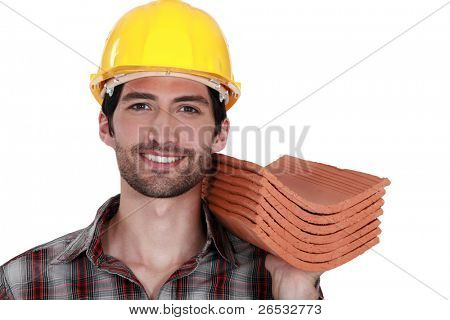 Tradesman holding shingles