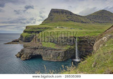 Steep Green Hills In The Faroe Islands