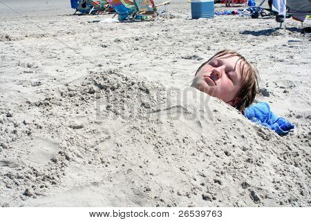 Teen Boy Buried In Sand