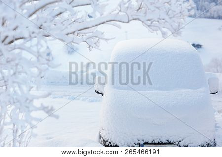 Car Covered With Snow After