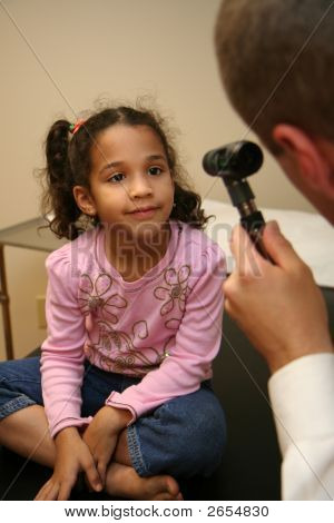 Doctor Checks Young Patient