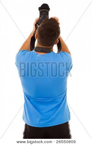 Young photographer with camera from the back, isolated on white
