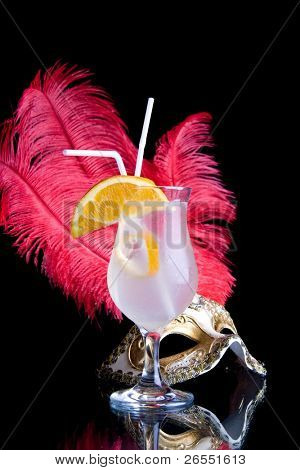 cocktail and Venetian mask on a black background.