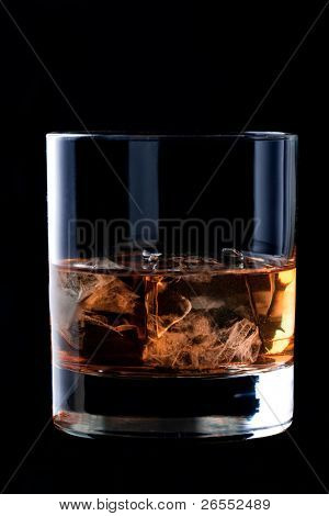 glass of whisky on black background.