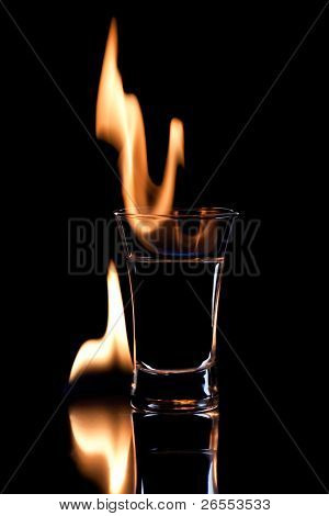 Flaming vodca over black