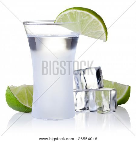 shot glass filled with clear cold alcohol