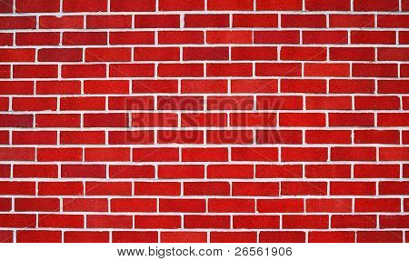 Wall of bright red bricks useful as a background