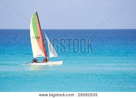 Small reacreational sailboat in a calm blue sea
