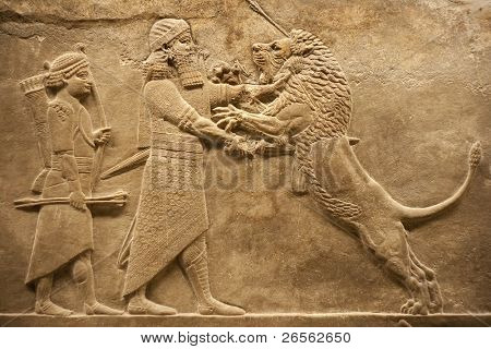 Old relief representing an assyrian warrior hunting lions