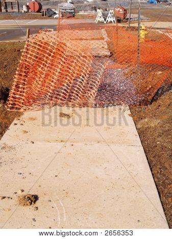 Orange Fence By Sidewalk Construction Area