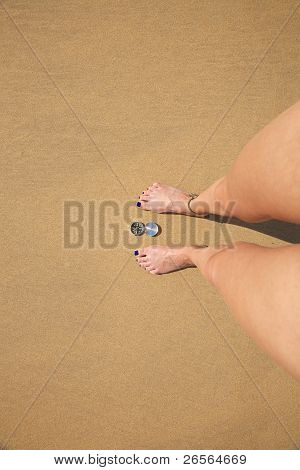Woman Legs With Silver Compass
