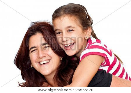 Small girl and her young latin mother hugging and laughing isolated on a white background
