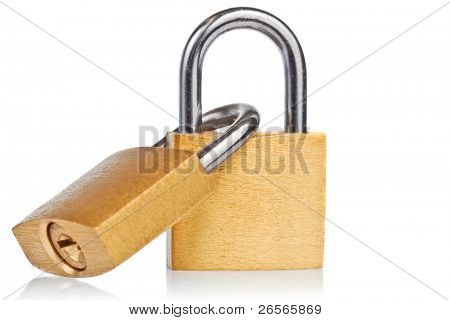 Two linked brass padlocks with reflections on a white background