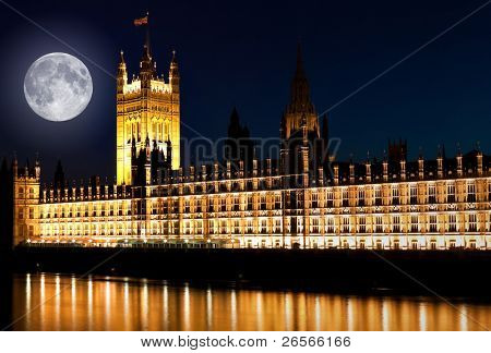The Houses of Parliament at night with a bright full moon