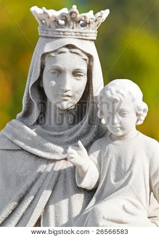 Marble statue of the Virgin and a child with a diffused green background