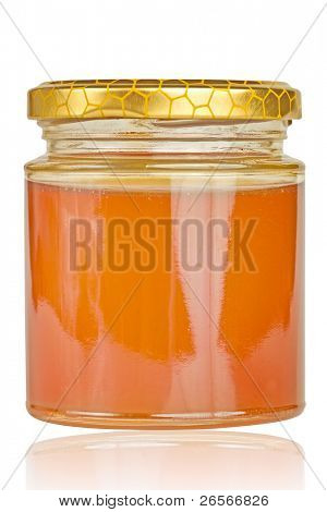 Jar of light golden honey isolated on a white background with reflections and clipping path