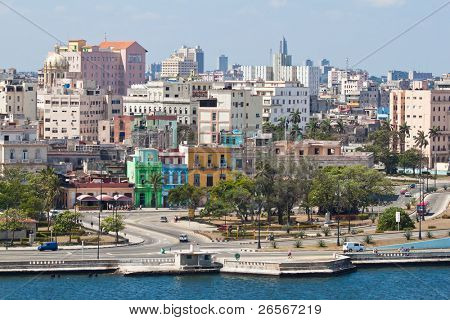 View of Old Havana with lots of colorful buildings and the bay in the foreground
