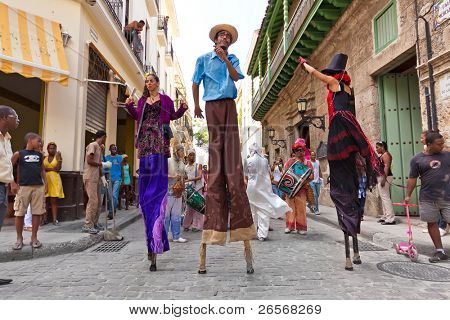 HAVANA-JUNE 4:Stilt dancers in Old Havana June 4,2011 in Havana.Artists performing in the colonial city help to give the area the colorful atmosphere which attracts over 1 million tourists a year