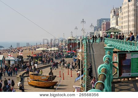 BRIGHTON,UK-MARCH 31:Visitors enjoy the beach March 31,2011 in Brighton.The seafront is full of bars and restaurants and being less than an hour from London has made the city a popular destination
