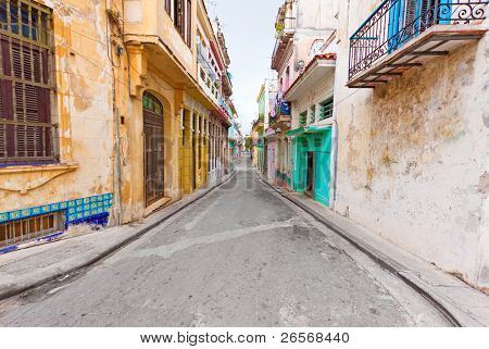 Colorful street in Old Havana sidelined with decaying buildings