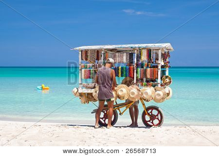 VARADERO,CUBA-JULY 16:Man selling  typical souvenirs July 16,2011 in Varadero.With over a million visitors per year,Varadero is most important destination for the growing cuban tourist industry