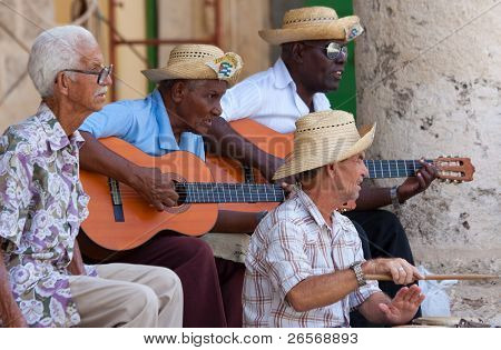 HAVANA-AUGUST 12:Street musicians August 12,2011 in Havana.With Cuba receiving over two million tourists a year people like these,usually working for tips;are part of the atmosphere of Old Havana