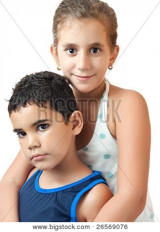 Small latin boy and girl hugging isolated on a white background