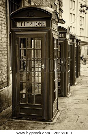 Group of old London phone cabins toned in sepia