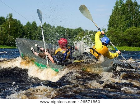 Kayaker extreme sporting a kayak cuts through water